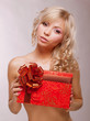 Donation. Beauty Blonde holding Red Box as a Present. Holiday