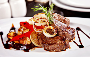 Beef steak with vegetables, rosemary and soy sause