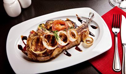 Fried pork with vegetables served in restaurant