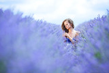 Fototapety Woman standing on a lavender field