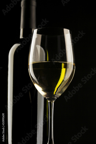 white wine glass silhouette black background