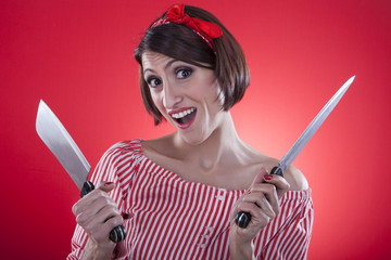 pin up girl holding a kitchen knife.