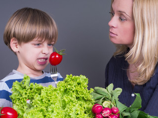 Mother and her son who does not like tomato and salad
