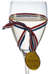 Glass of white wine with medal winner