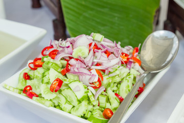 "The preserved cucumber is the side dish of ""Satay pork """