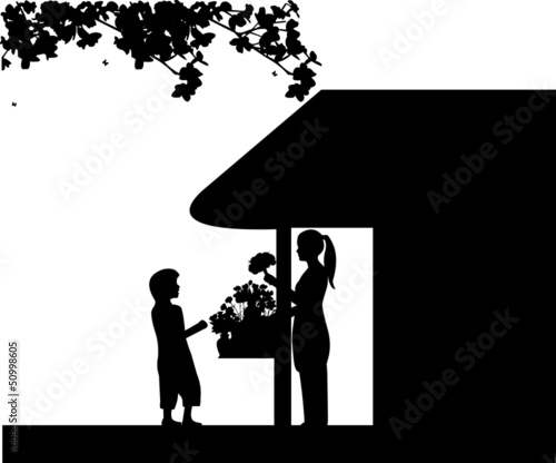 Florist girl holding a flowers in flower shop and sales the boy