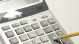 Man working with a calculator. Close up.