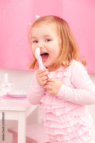 laughing baby with spoon