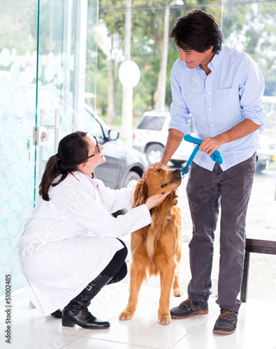Man taking dog to the vet