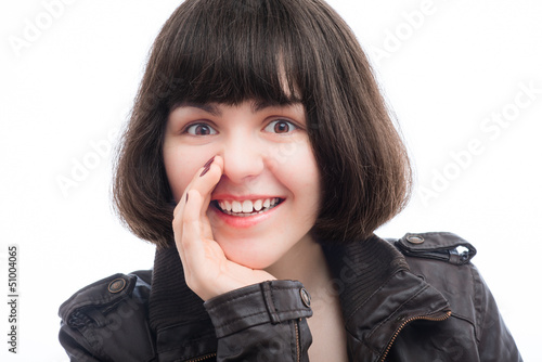 woman holding hand near mouth and something points