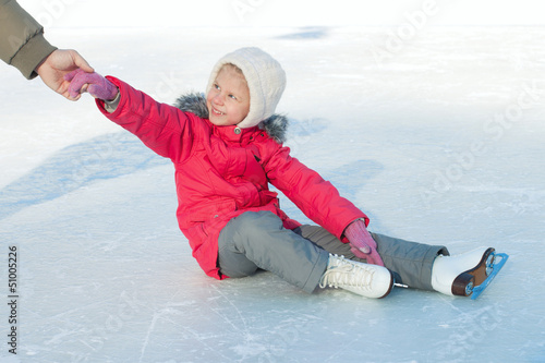 A child learns to skate