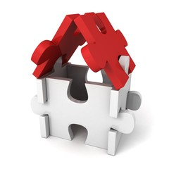white toy puzzle house with red roof