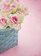 Dreamy romantic pink roses in a basket