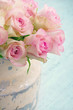 Roses in a shabby chic metal bucket