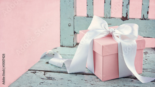 Gift box on a blue wooden chair