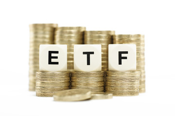 ETF (Exchange Traded Fund) on gold coins on white background