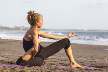 Slim woman practicing yoga doing hard exercise