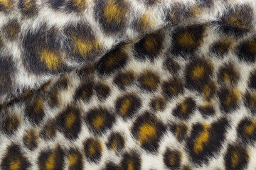 close up shot of fake leopard tiger fur texture background