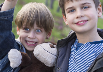 Happy brothers and their monkey doll