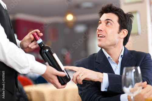 Man talking with waiter