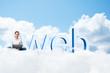 girl sitting cross-legged on the clouds
