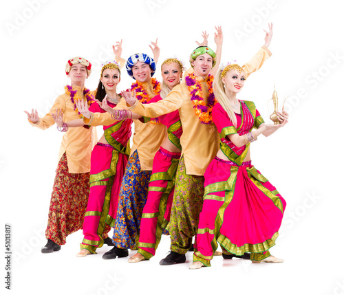 dancers dressed in Indian costumes posing