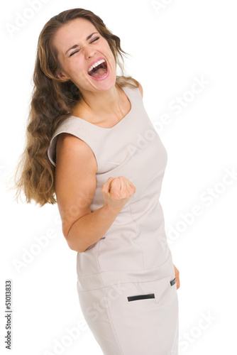 Portrait of happy young woman rejoicing success