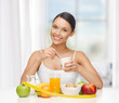 woman with healthy breakfast and measuring tape