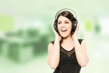Beautiful bruneete woman with headphones