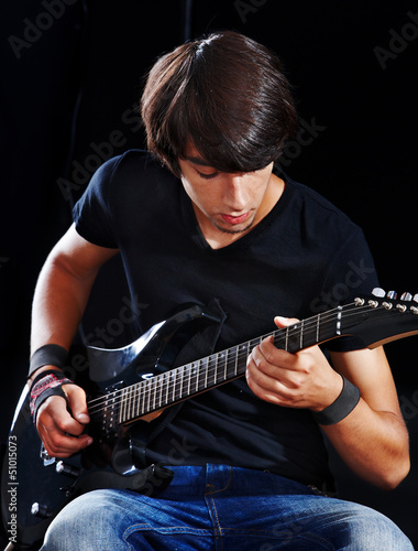 Man playing  guitar.