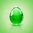 Glass Easter egg on green background