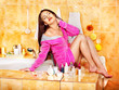 Woman relaxing at home bath.