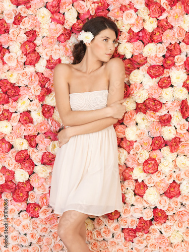 young woman with background full of roses