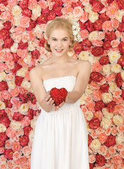 woman with heart and background full of roses
