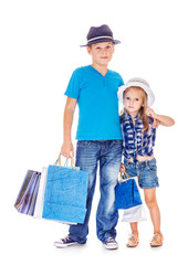 Boy and girl with customer paper bags