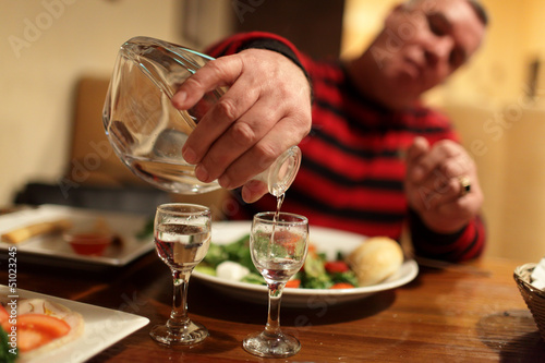 Man with decanter of vodka