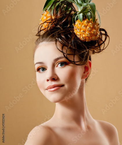 Beautiful woman with a pineapple in her hair