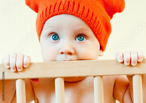 baby in a crib in the cap