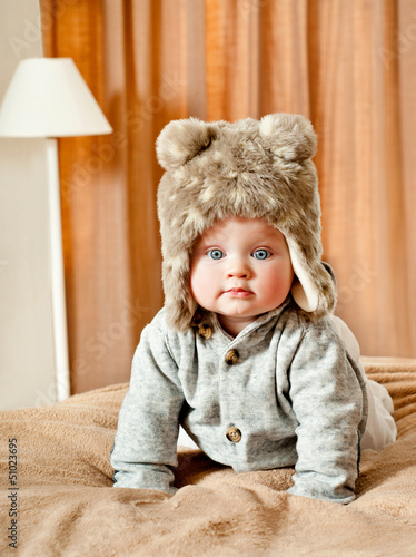 baby in winter fur hat