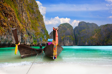 traditional Thai boats in the Maya Bay of Phi-Phi island