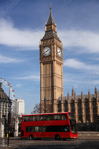 Big Ben with red double decker in London, UK