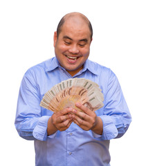 An office guy holding pile of Thai banknotes with his face sweat