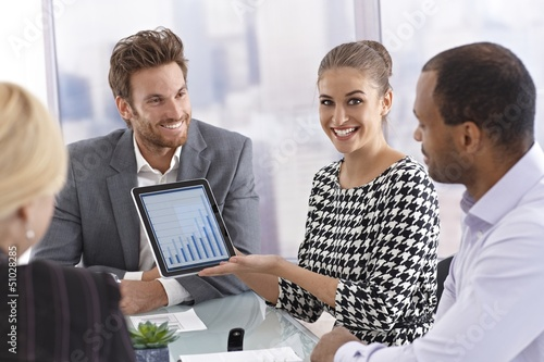 Happy businesswoman holding tablet computer