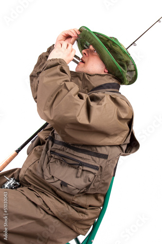 A portrait of a fisherman with fishing pole