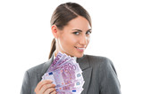 Business Woman holding and showing a lot of five hundred euro ba