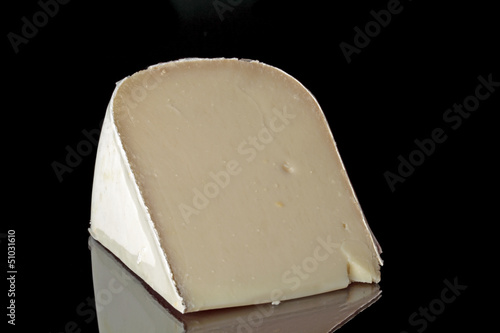 Dutch goat cheese on a black background