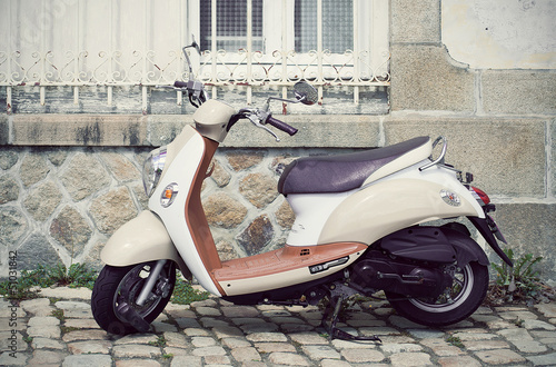 Vespa motorcycle parked in the street - 51031842