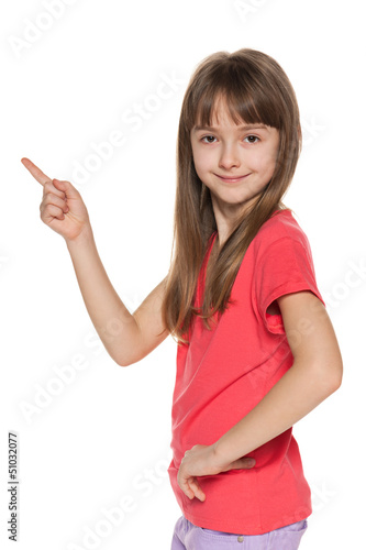Young girl shows her finger to the side