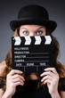 Woman with movie clapper board