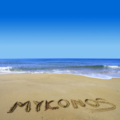 Mykonos written on sandy beach